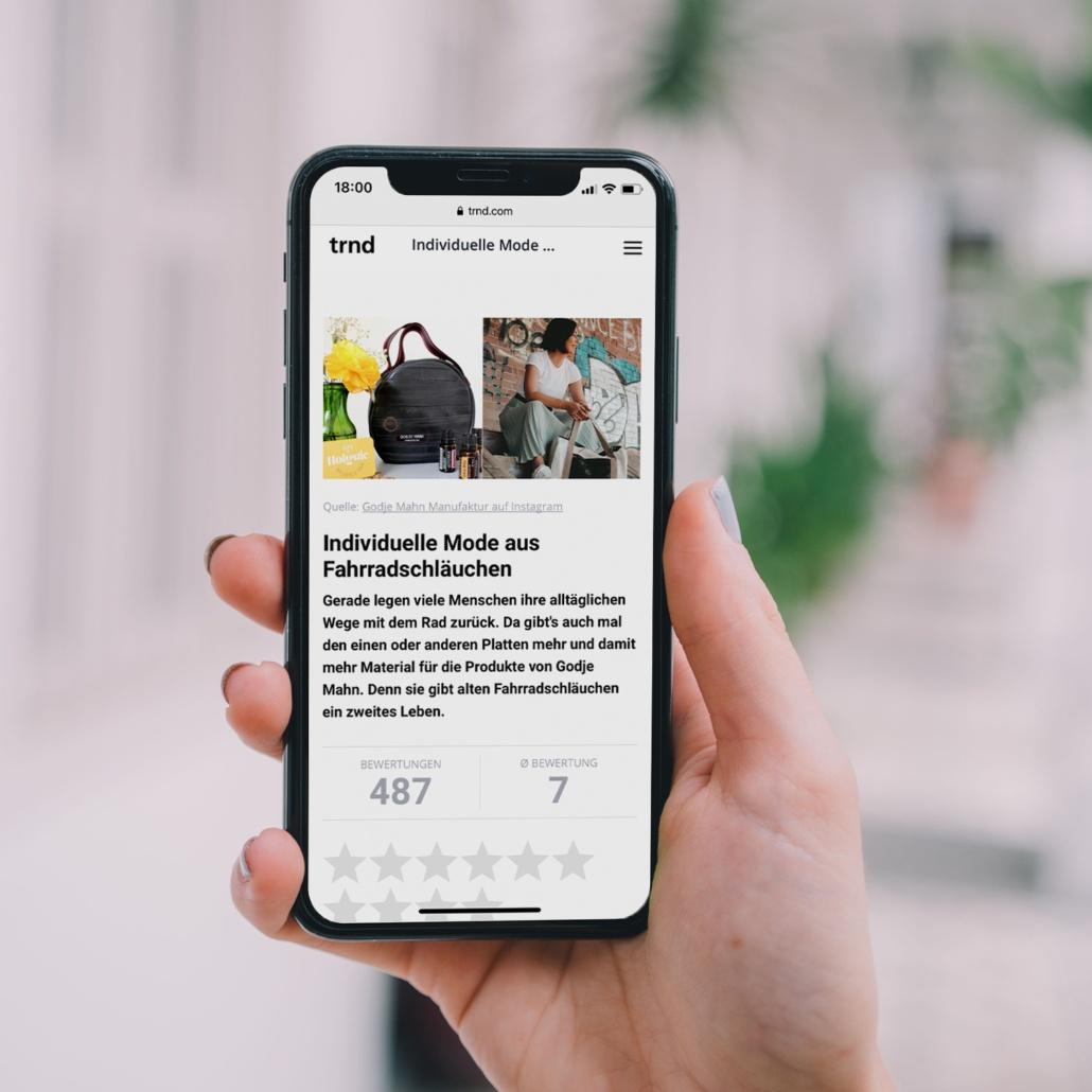 iPhone mit trnd Artikel über die Godje Mahn Manufaktur